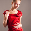 Sexy young blond woman in red — Stock Photo