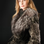 Attractive woman in fur coat — Stock Photo