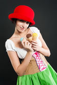Pretty girl in german style with ice cream — Stock Photo