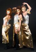 Three pretty girls dancing — Stock Photo