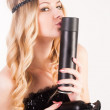 Attractive woman with hairspray — Stockfoto