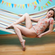 Young womlying in hammock — Stock Photo #27634375