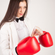 Young businesswoman in boxing gloves — Stock Photo