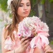 Beautiful woman with flower... — Stock Photo #28142135