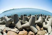 Concrete breakwater of Baltic sea channel — Stock Photo