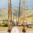 Old suspension bridge above Katun — Stock Photo