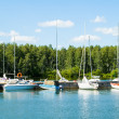Boats and yachts at old pier — Stock Photo