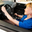 Stock Photo: Smiling woman on drive