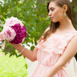 Attractive woman with flowers — Stok fotoğraf