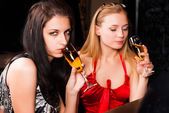 Beautiful women with red wine glasses — Stock Photo