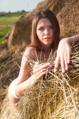 Sexy girl on hay stack — Stock Photo