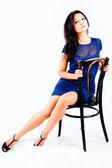 Menina bonita na cadeira — Fotografia Stock