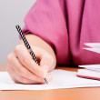 Woman writing in organizer — Stock Photo