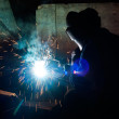 图库照片: Skilled working factory welder