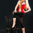 Sexy blonde woman with chair — Stock Photo