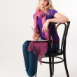 Pretty blonde girl on chair — Stock Photo