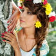 Attractive woman with flower wreath — Stock Photo