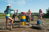 Young women on old gasoline station — Stock Photo