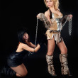 Two girls in barbarian and cat costumes — Stock Photo