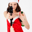 Beautiful Santa woman with gun — Stock Photo
