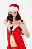 Beautiful Santa woman with gun — Stockfoto