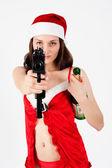 Schöne santa-frau mit waffe — Stockfoto
