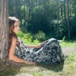 Pretty girl under tree — Stock Photo #32603635