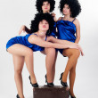 Three pretty dancers with old suitcase — Stock Photo