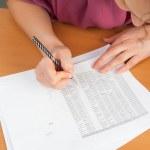 Woman writing in organizer — Stock Photo