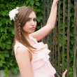 Attractive woman with flower hairstyle — Stock fotografie