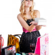 Blond woman with shopping bags and gift — Stock Photo