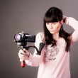 Young woman with video camera — Stock Photo