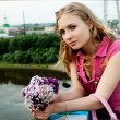 Pretty woman holding a bouquet — Stock Photo