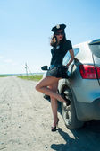 Sexy police woman on road — Stock Photo