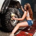 Sexy woman washing car — Stock Photo