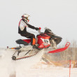 Sport snowmobile jump — Stock Photo
