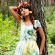 Attractive woman with flower wreath — Stockfoto