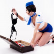 Young beautiful air hostess  with suitcase — Stock Photo