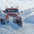 Truck cleaning road in winter — Stok fotoğraf