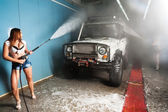 Sexy woman washing car — Stock Photo