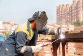 Industrial worker welder during working process — Stok fotoğraf