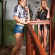 Pretty women in old house — Stock Photo