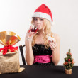 Blond woman with gift bag — Stock Photo