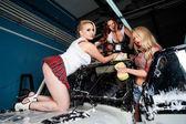 Sexy women washing car — Stock Photo