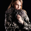 Attractive woman in fur coat — Stock Photo #38020651