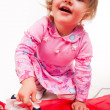 Little, blond hair girl ironing — Stock Photo