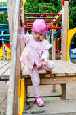 Little girl in the playground — Stock Photo