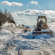 Truck cleaning road in winter — Stock Photo #38974367