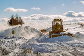 Grader cleaning road in winter — Stock Photo