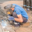 Industrial worker welder during working process — Stock Photo